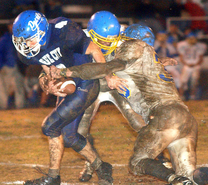 Gate City's Payton Jenkins, #4, tries to hold onto the ball and gain yardage while two Appalachia defenders try to strip the ball away. Photo by Ned Jilton II