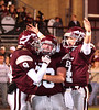 DB #9 Coty Sensabaugh, #69 Patrick Fleming and #4 Bo Burton celebrate after scoring a touchdown. Photo by Erica Yoon