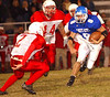 Gate City's #8, Dustin Jones, eyes Kelly's Matt Dotson, #2 while eludeing two other Kelly tacklers. Photo yb Ned jilton II