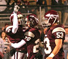 DB #9 Coty Sensabaugh, #20 Josef Throp and #53 Justin Basham celebrate after a touchdown. Photo by Erica Yoon