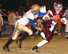 Dobyns Bennett QB Bo Burton, #4, rolls out to escape a Knox Karns defender. Photo by Ned Jilton II