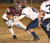 Cody Sensabaugh attempts to elude a William Blount defender. Photo by Ned Jilton II