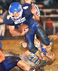 #4, Payton Jenkins, for Gate City lunges forward out of the grip of #30 Brett Leedy of Appalachia. Photo by Ned Jilton II