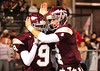 DB #9 Coty Sensabaugh and #4 Bo Burton celebrate after a touchdown. Photo by Erica Yoon