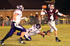DB #4 Bo Burton tries to throw a pass and outrun Sevier County #54 and #41. Photo by Erica Yoon