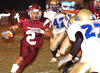 #2, Marchez Barnes of Dobyns Bennett eyes Knox Karns defender as he rounds the end of the line. Photo by ned Jilton II