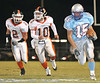 Sullivan South #15 Taylor Fletcher runs down past Central #2 Andrew Griffith and #10 Carl Roberts. Photo by Erica Yoon