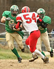 Clintwood #8 Chris Robinson tries to run past Holston #54 with the help from his teammate #12 Ryan Lyle. Photo by Erica Yoon
