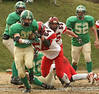 Clintwood #28 Alec Osborne runs down past Holston #54. Photo by Erica Yoon