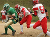Clintwood #8 Chris Robinson runs away from Holston #23 and #54. Photo by Erica Yoon