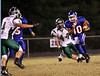 Volunteer's Quarterback Luke Cradic runs down the field while Greenville defender #44 pursues.  Photo by Kyle Stinson.
