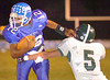 Gate City QB, #12, Tihlee Anderson, pulls away from John Battle's #5 Sage Evans for big gain during first quarter action. Photo by Ned Jilton II