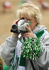 Madison Chappell, mother of Clintwood HS #7 quarterback Heath Counts, videotapes the wild crowd during the semi final state game against Holston. Photo by Erica Yoon