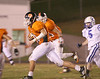 Sullivan Central's Josh Russell (#50) rushes toward the endzone with Unicio in pursuit.  Photo by Kyle Stinson.
