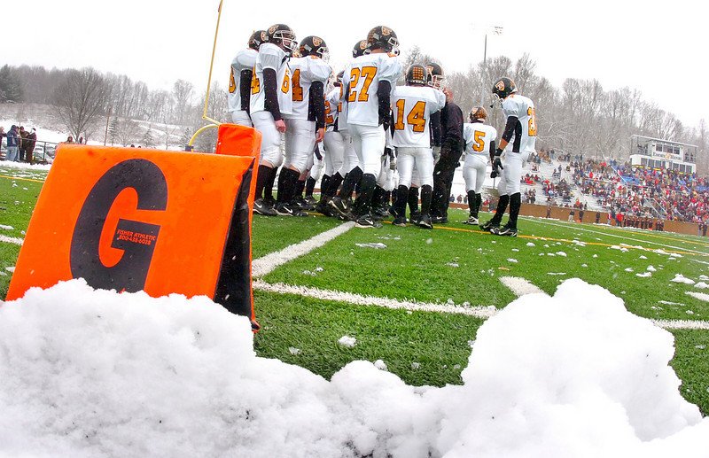 With snow still falling, the J. I. Burton Raiders wait to take the field for the VHSL state semi-finials against Holston. Photo by Ned Jilton II