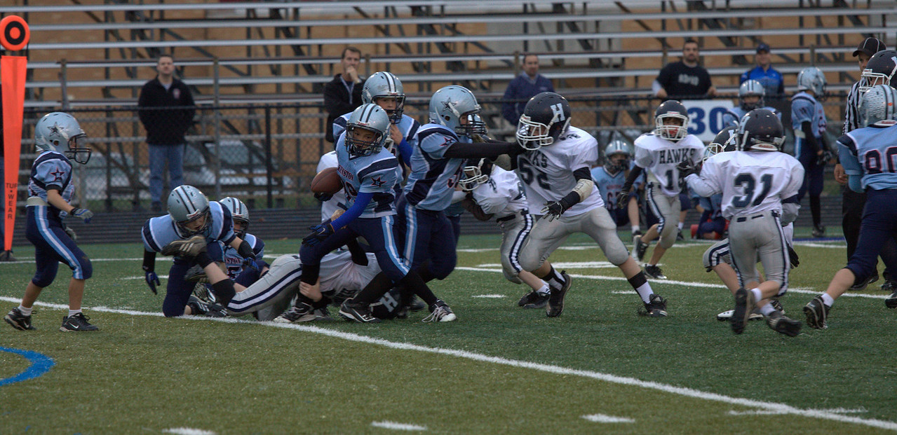 Look at Jack underneath the ball carrier - he never lets go and pulls him down a second after this shot.