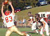 Daniel Boone's #83, Zach Johnson, attempts to pull in a pass as the Crockett defnese watches. Photo byNed Jilton II