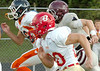 Runners fight for honors in the fastest back compition during the Big 8 football jamboree. Photo by Ned Jilton II