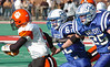 #9 for Honaker has nowhere to go as Gate City's #62, Payton Sivert and #25, Derick Miller, run him down in the back field. Photo by Ned Jilton II