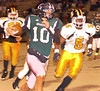 #10 for Eastside picks up big yardage and sets-up the Spartan's first touchdown. Photo by Ned JIlton II