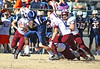 Union running back #23 is brought down by a quartet of Stuarts Draft defenders on a rushing play. Photo by Jonathan McCoy.