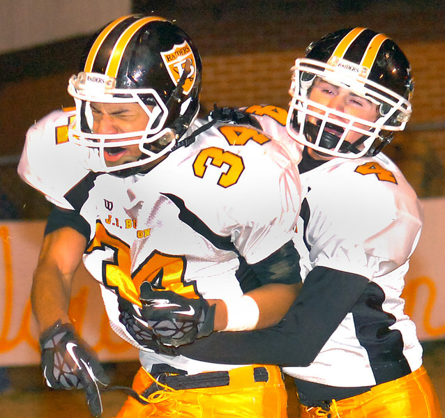 #34 and #4 for Burton celebrate after 34 scores another TD. Photo by Ned JIlton II