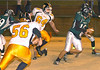 #10 for Eastside slips through the Burton defense to pick-up yardage. Photo by Ned Jilton II (Note I think this is the Eastside QB that was later injured and taken to the hospital)