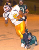 #5 for Burton escapes the tackle of #13 for Eastside to score. Photo by Ned Jilton II