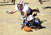 Union's #23 and Stuarts Draft's #23 dive for a fumble on a mishandled kickoff return attempt by Union's #23. Stuarts Draft recovered the ball. Photo by Jonathan McCoy.