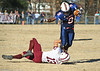 Union's #9 is tripped up by Stuarts Draft's #13 after catching a pass during the second quarter of Saturday's game. Photo by Jonathan McCoy.