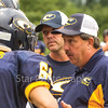 Star Photo/Larry N. Souders<br /> Cloudland head coach Mike Lunsford gives last minute instructions to members of his secondary just prior to the start of Friday nights game against the Eagles of Oakdale.