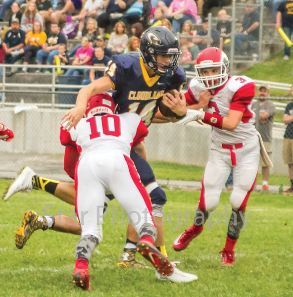 Star Photo/Larry N. Souders<br /> The Highlanders' starting quarterback Preston Benfield (14) scores Cloudland's second touchdown of the first quarter Friday night against the Eagles of Oakdale.