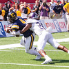 Star Photo/Larry N. Souders<br /> ETSU wide receiver Vincent Lowe (4) turns and stretches for the goal line scoring what would prove to be the Game winning touchdown for the Bucs.
