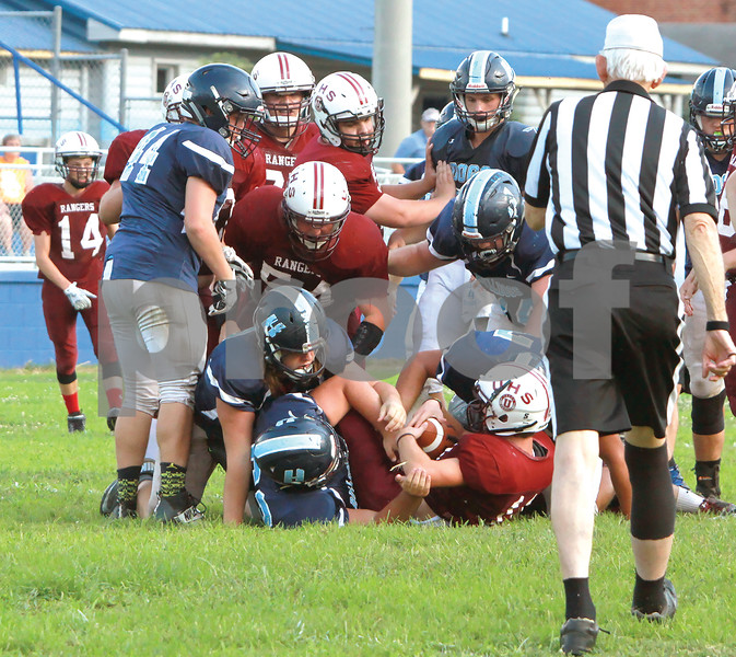 Unaka running back (11) runs into a wall of Bulldogs during a Friday night scrimmage at Hampton.<br /> Star Photo/Larry N. Souders