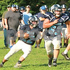 With Clay Letcher (63) leading the way Hampton running back Macon Barden (22) looks to change direction during the Friday evening scrimmage against Unaka.<br /> Star Photo/Larry N. Souders