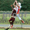 A Cougars receiver (2) leaps over Unaka defender (15) for a touchdown catch during a three-way scrimmage Friday evening at Hampton High School.<br /> Star Photo/Larry N. Souders