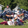 Star Photo/Larry N. Souders<br /> A swarm of Hampton Bulldogs stop a Johnson County runner for a loss.