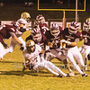Star Photo/Larry N. Souders<br /> A swarming defense by the Warriors corrals Rockwoods' Zander Price (7) after only a short gain.