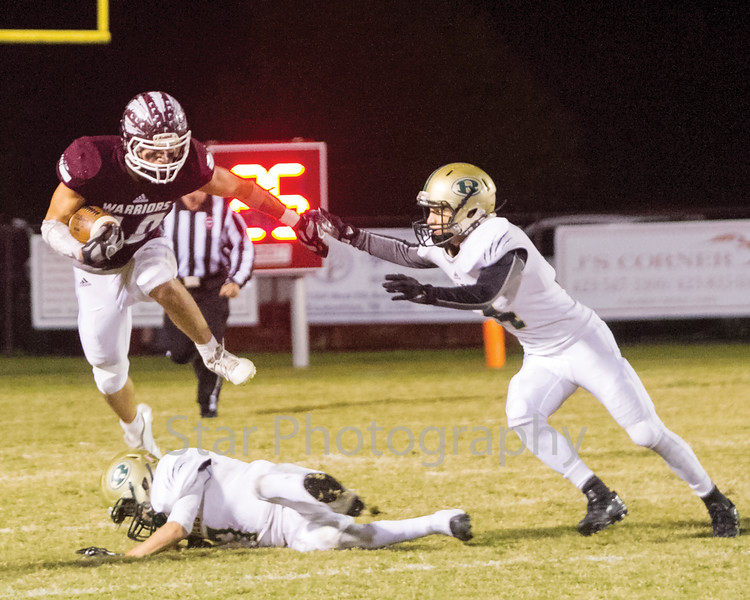 Star Photo/Larry N. Souders<br /> Happy Valley running back Austin Hicks (34) leaps over a Tiger defender on a screen pass for a first down early in the second quarter.