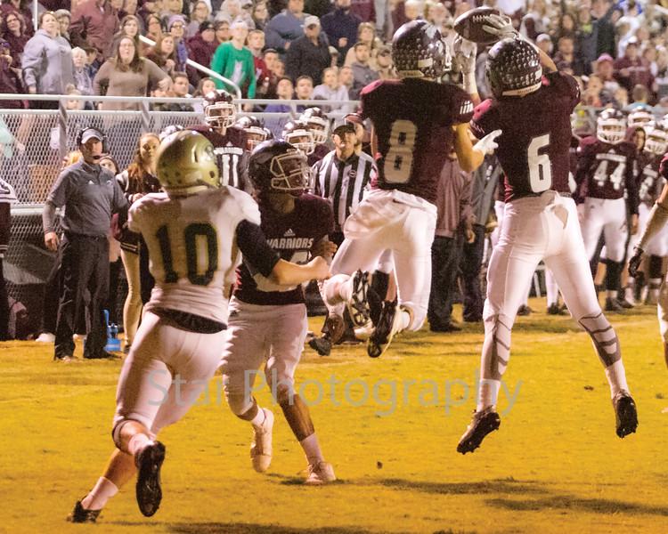 Star Photo/Larry N. Souders<br /> With three Warrior defenders converging on him Rockwood's Dylan Williams (10) watches as Happy Valley's Skyler Hyatt (6) intercept the pass near the ten yardline.