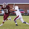 Star Photo/Larry N. Souders<br /> The Warrior's Brayden Sams (10) works to make a cut on the corner against Unaka's Hunter Rice.