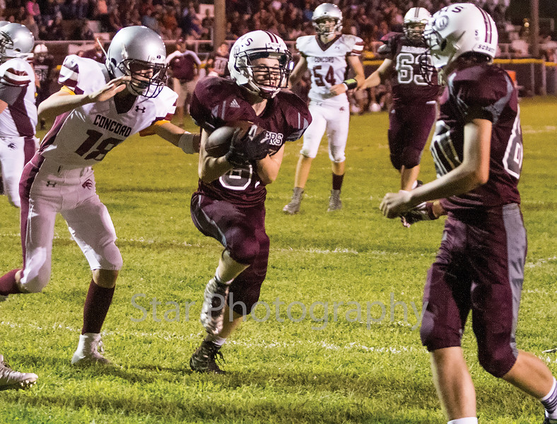 Star Photo/Larry N. Souders<br /> The Ranger's Logan Godsey (81) cracks a smile as he crosses the goal line scoring a third quarter touchdown against the Lion's of Concord.