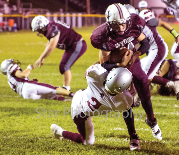 Star Photo/Larry N. Souders<br /> Unaka tailback Hunter Bentley (11) bulls his way over the Lion's Aaron Borthwick (2) and into the end zone for the Rangers final touchdown of the first half Friday night.