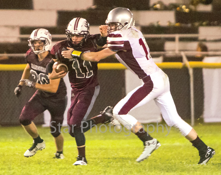 Star Photo/Larry N. Souders<br /> Ranger tailback Hunter Bentley (11) stiff arms a Concord's Matthew Massengill (17) as he breaks off a long run near the end of the first half Friday night.