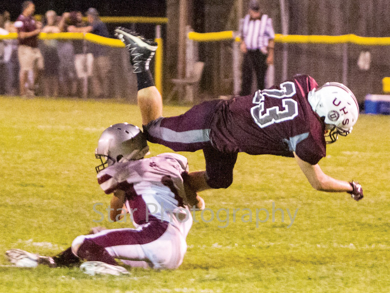 Star Photo/Larry N. Souders<br /> Unaka's Hunter Rice (23) gets tripped up by Concord's Raefe Keyes (1) as he tries to turn up field on a swing pass play.