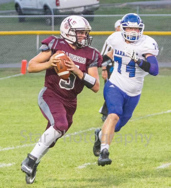 Star Photo/Larry N. Souders<br /> Ranger quarterback Blake King (5) is flushed out the pocket by a Harriman defender.