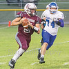 Star Photo/Larry N. Souders<br /> Ranger quarterback Blake King (5) is flushed out the pocket by a Harriman defender.