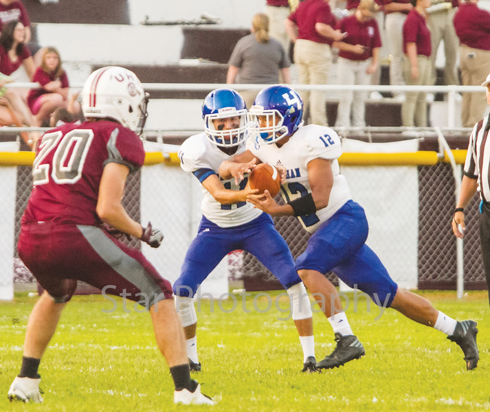 Star Photo/Larry N. Souders<br /> Scoring on the first play from scrimmage the Blue Devils from Harriman were off the to races as quarterback Joe Pace (11) hands of to T.J. Phipps (12) for a 60 yard touchdown run up the middle.