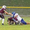 Star Photo/Larry N. Souders<br /> On third and long Harriman D. Hoey (55) stuffs the run up the middle of Unaka's Austin Taylor.
