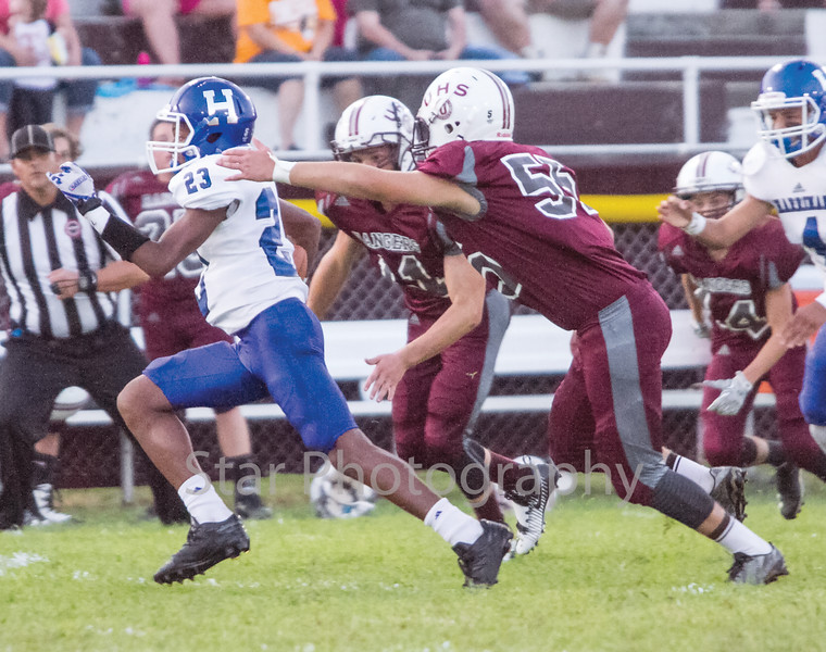 Star Photo/Larry N. Souders<br /> After a three and out by Unaka, the Blue Devils' Isaiah McClain (23) take a quick out pass 55 yards for Harriman's second touchdown in the first minute of play.